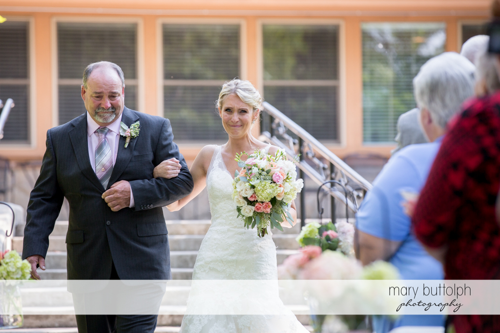 Bride and her teary-eyed father walk down the aisle at Arrowhead Lodge Wedding