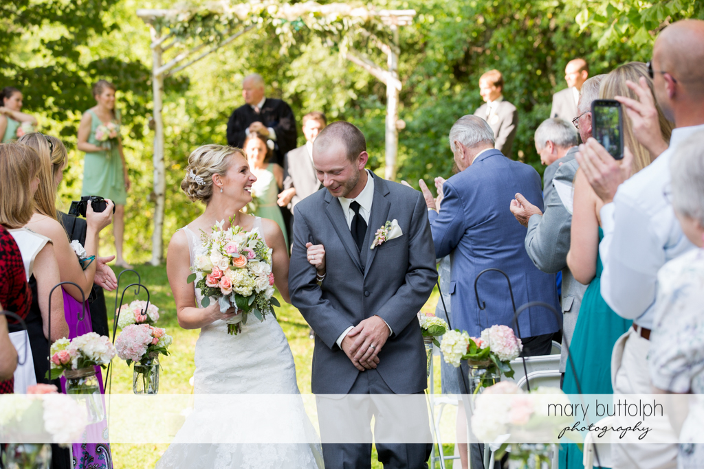 Guests applaud the couple after the wedding ceremony at Arrowhead Lodge Wedding
