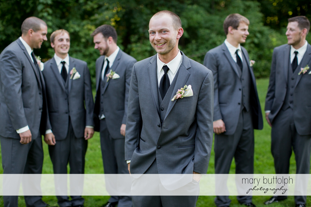 Groom and his groomsmen in the garden at Arrowhead Lodge Wedding