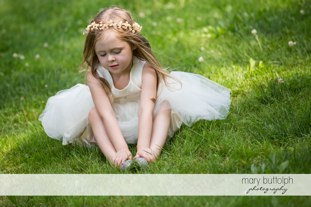 Flower girl in the garden at Arrowhead Lodge Wedding