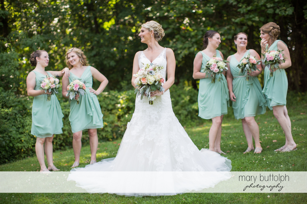 Bride and her bridesmaids in the garden at Arrowhead Lodge Wedding