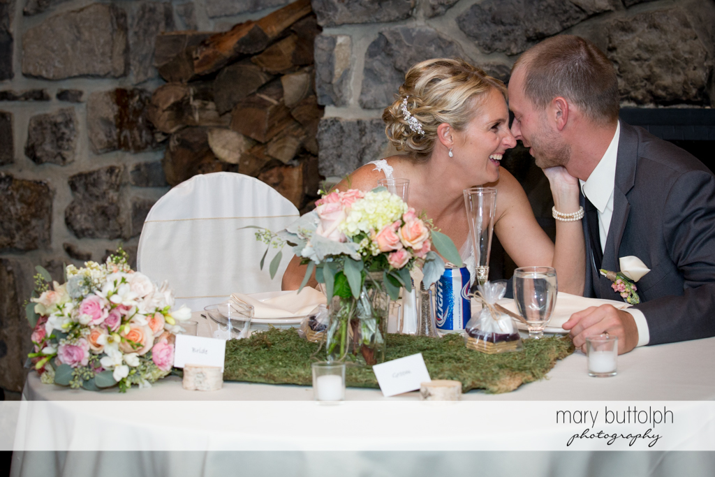 Couple rub noses at the wedding venue at Arrowhead Lodge Wedding