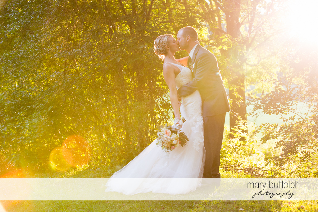 Couple kiss in the garden at Arrowhead Lodge Wedding