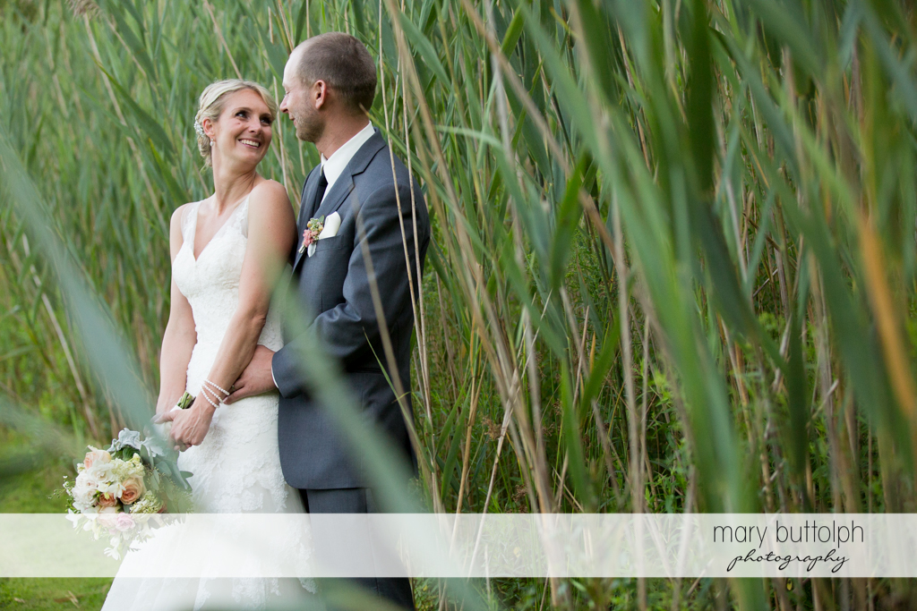 Couple pose in the garden at Arrowhead Lodge Wedding