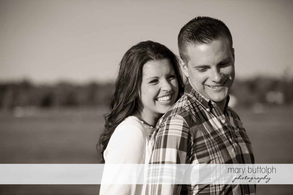 Couple can't hide their happy faces in this photo shoot at Skaneateles Country Club Engagement