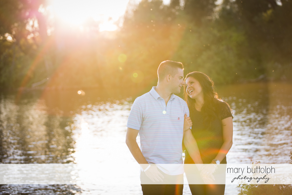 Couple pose in front of the lake at Skaneateles Country Club Engagement