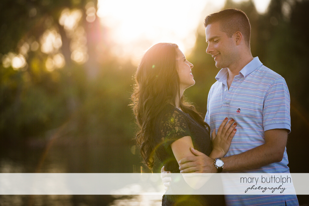 Couple embrace in the garden at Skaneateles Country Club Engagement
