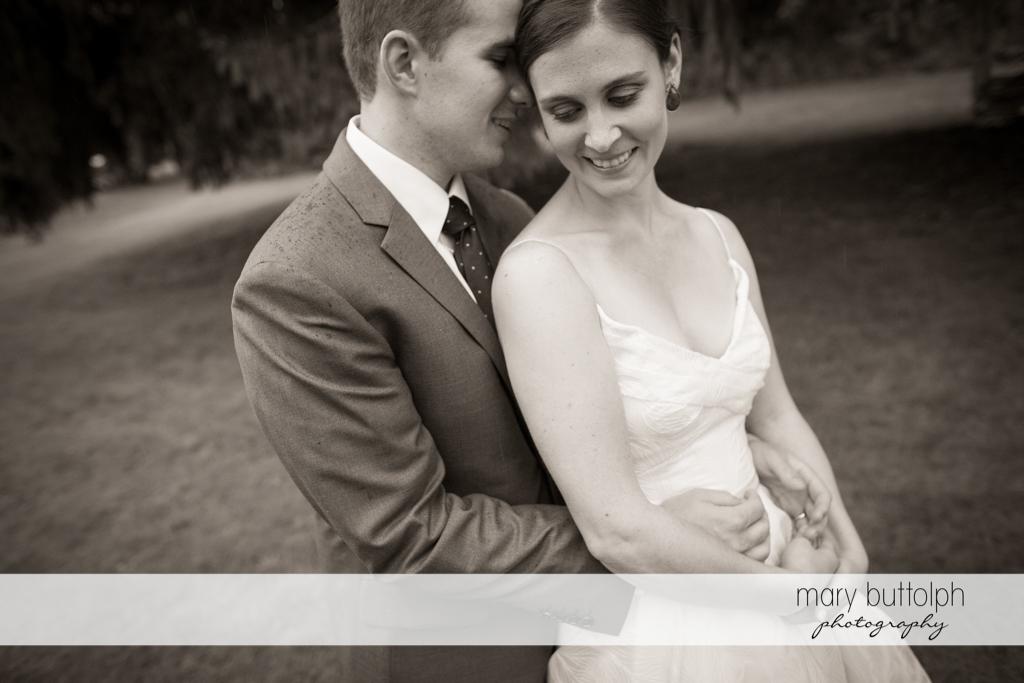 Couple share a quiet moment in the garden at the Hamilton Inn Wedding