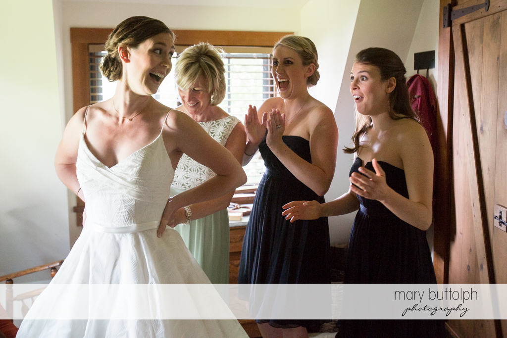 Bride and her bridesmaids look surprised at the Hamilton Inn Wedding