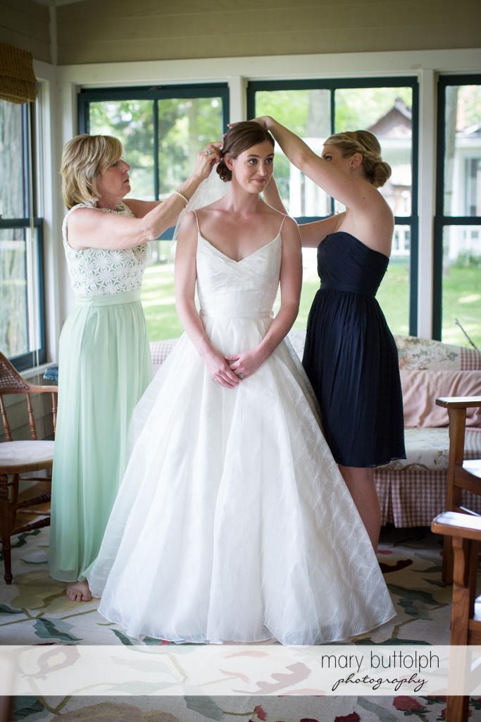 Bride's hair is fixed by friends at the Hamilton Inn Wedding