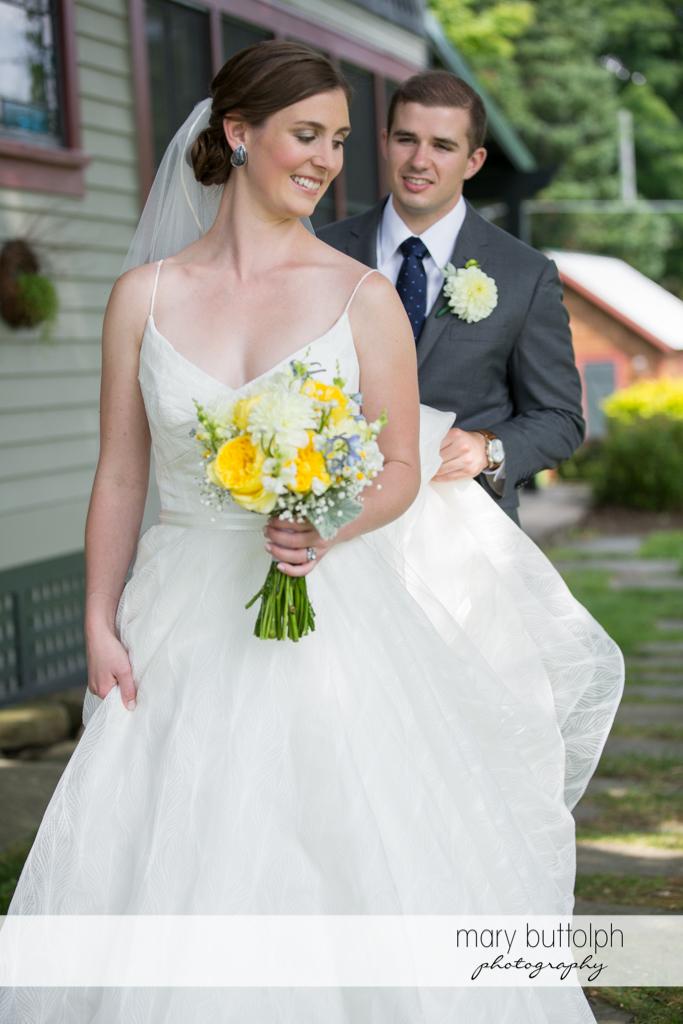 Couple pose in the garden at the Hamilton Inn Wedding