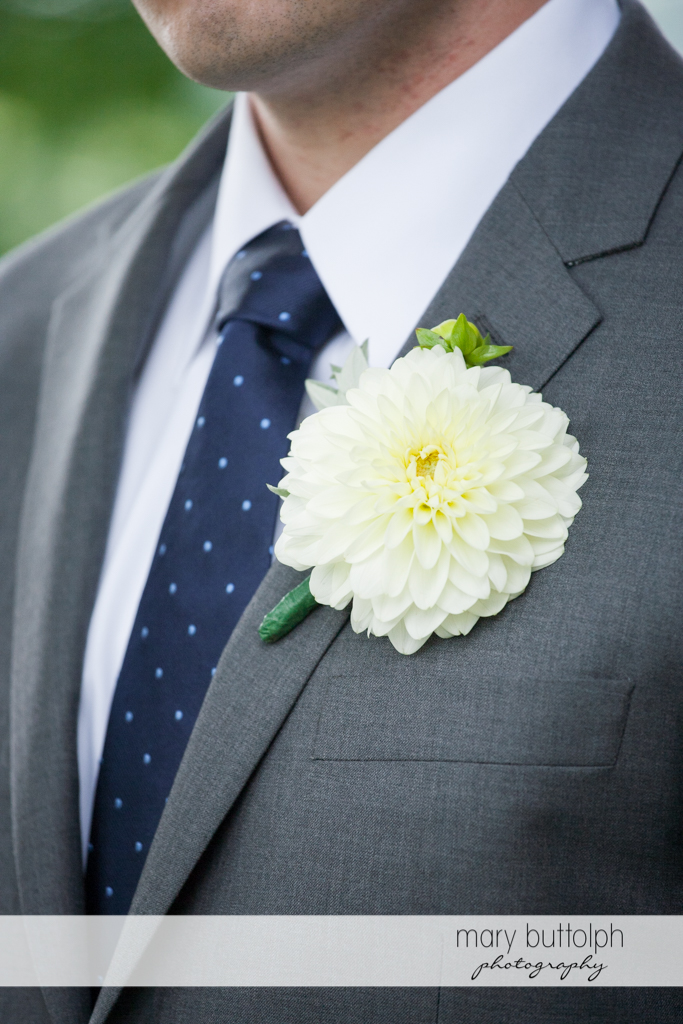 Close up shot of the groom's boutonniere at the Hamilton Inn Wedding