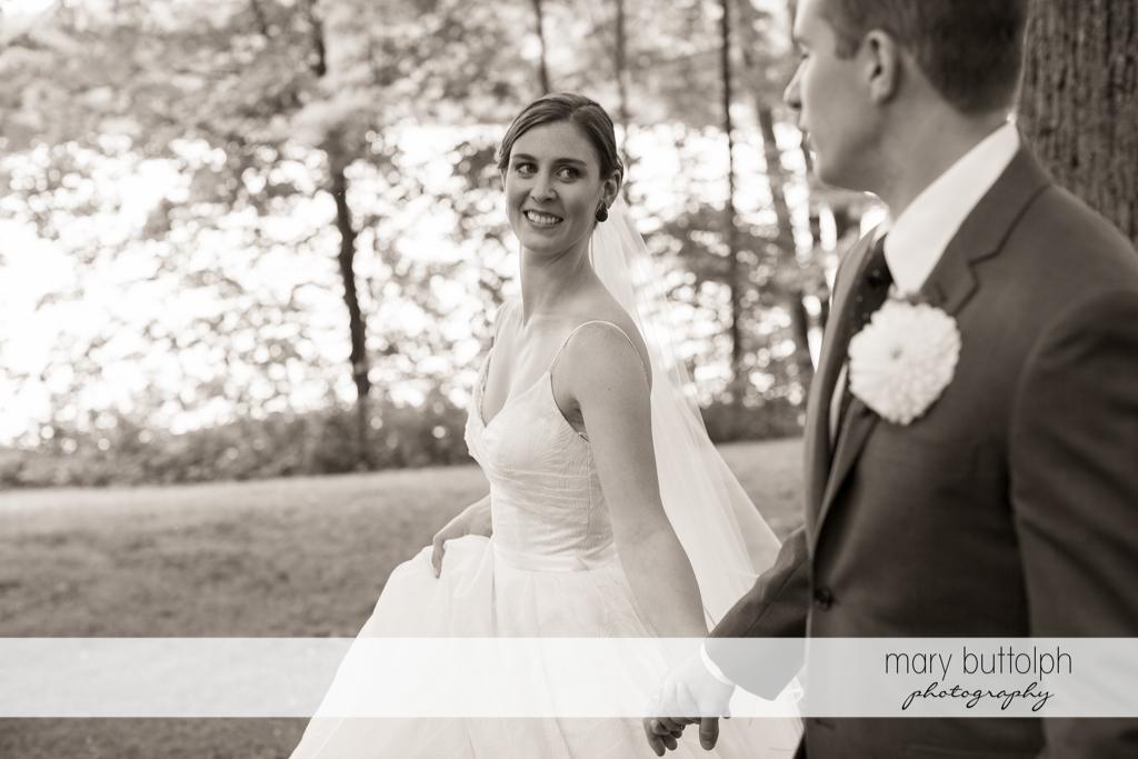 Couple stroll in the woods at the Hamilton Inn Wedding