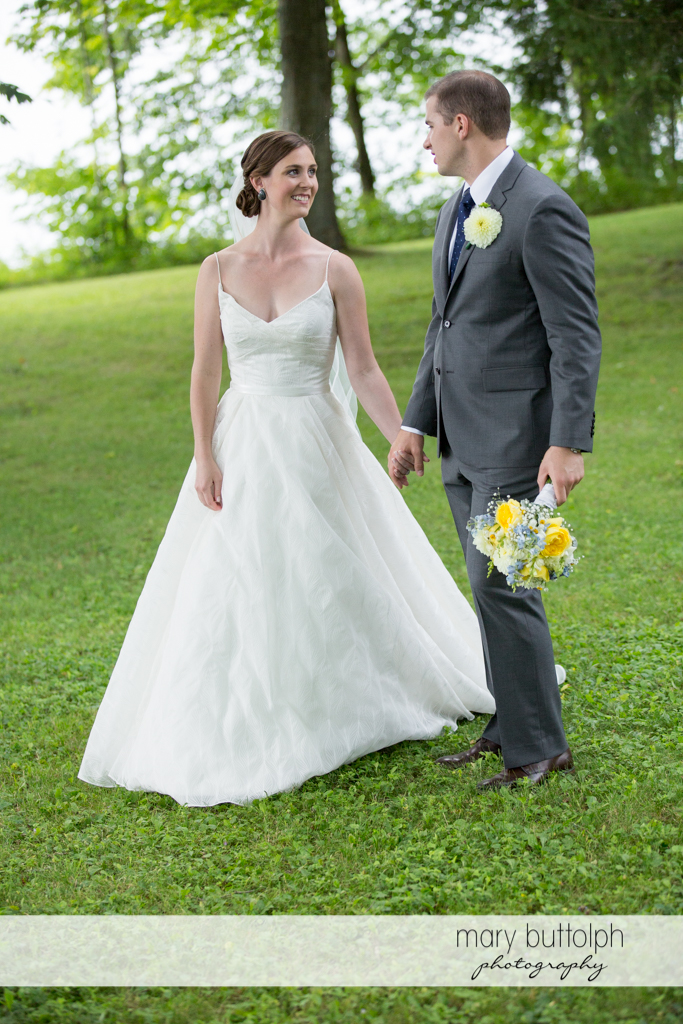Couple pose in the woods at the Hamilton Inn Wedding