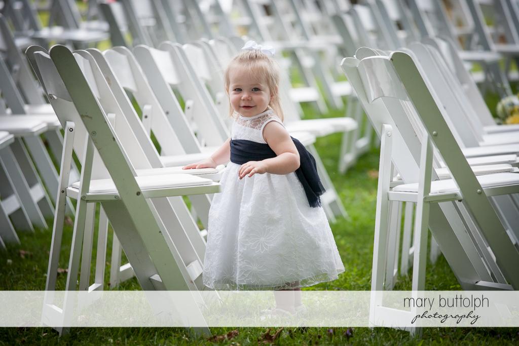 Smiling flower girl at the wedding venue at the Hamilton Inn Wedding