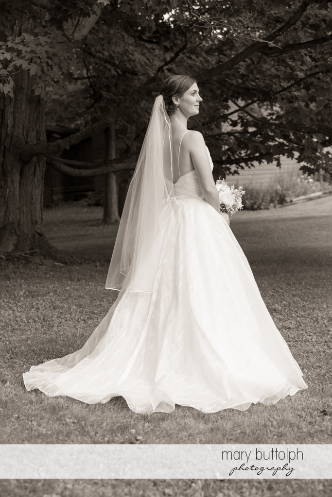 Dramatic black and white shot of the bride in the woods at the Hamilton Inn Wedding