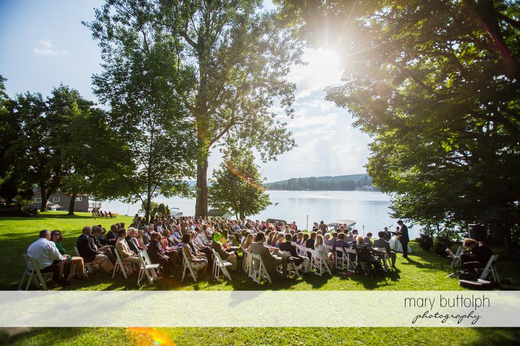 Guests attend the garden wedding near the lake at the Hamilton Inn Wedding