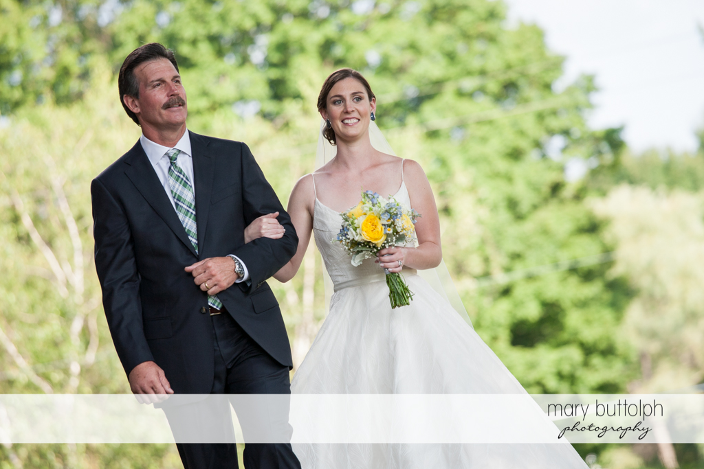 Bride is escorted by her father to the wedding venue at the Hamilton Inn Wedding