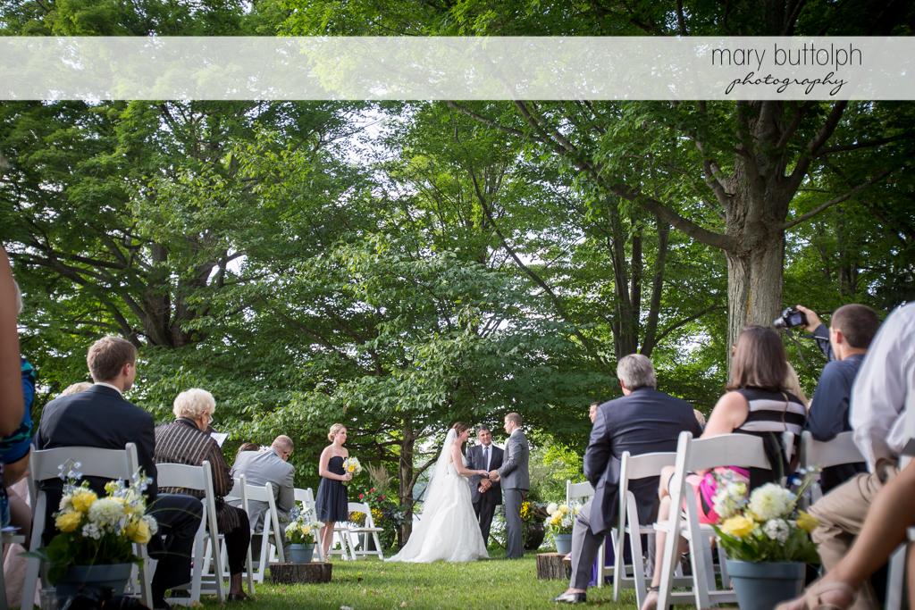 Long shot of the couple at the garden wedding at the Hamilton Inn Wedding