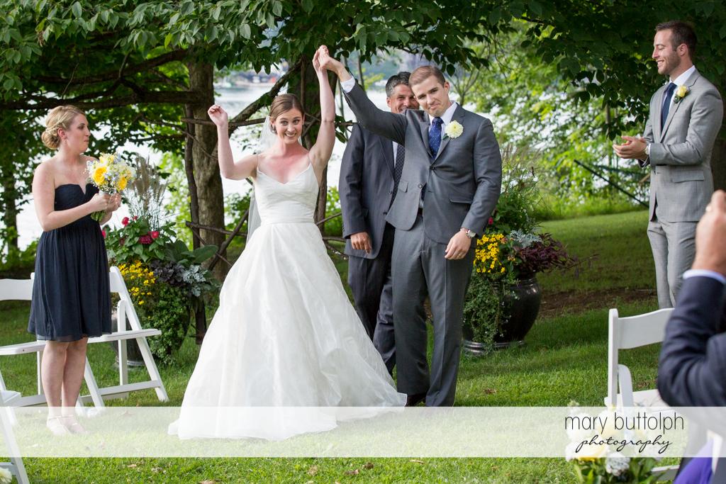 Couple raise their hands after the wedding at the Hamilton Inn Wedding