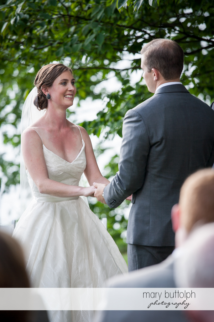 Couple hold hands and face each other in the garden at the Hamilton Inn Wedding