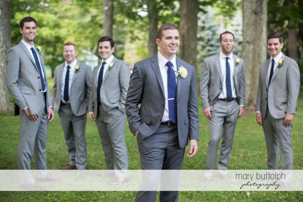 The groom and his groomsmen in the garden at the Hamilton Inn Wedding