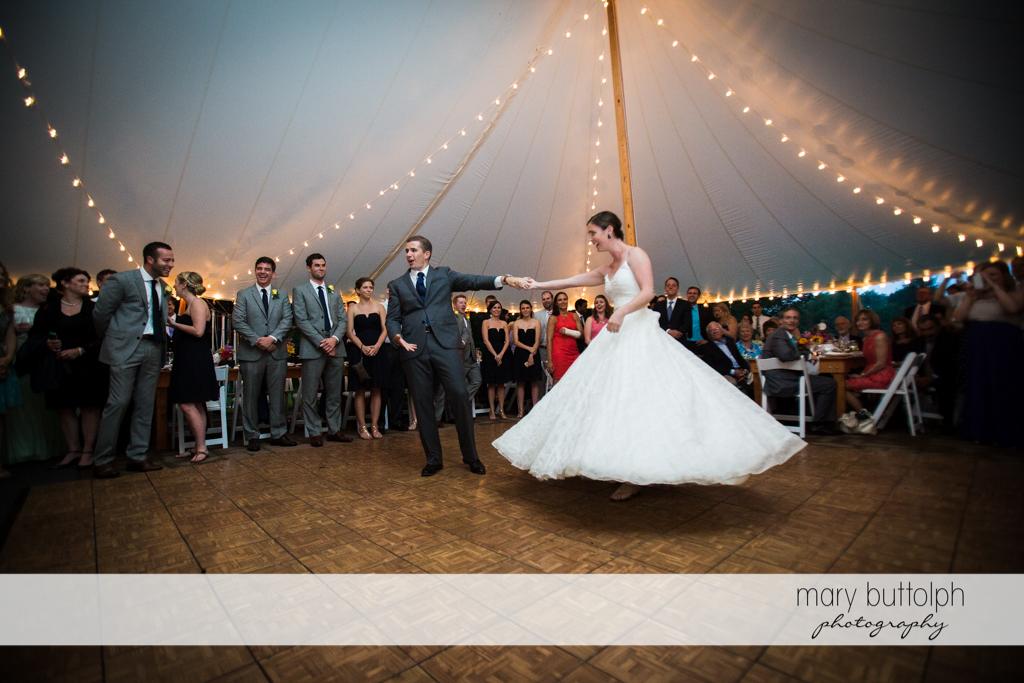 Couple dance in the wedding tent at the Hamilton Inn Wedding
