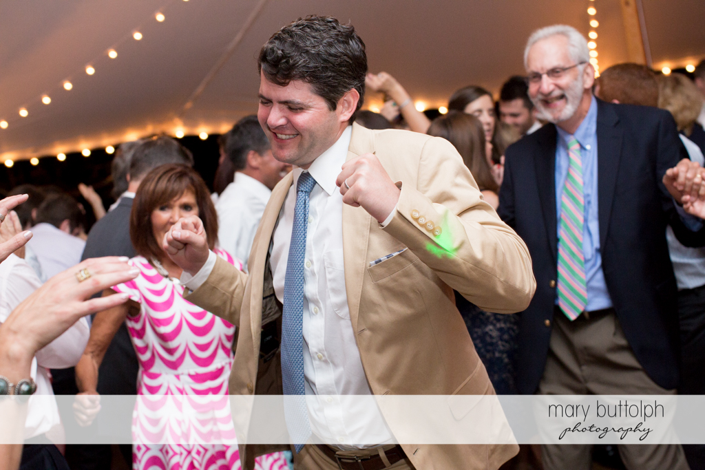 Guests party at the wedding venue at the Hamilton Inn Wedding