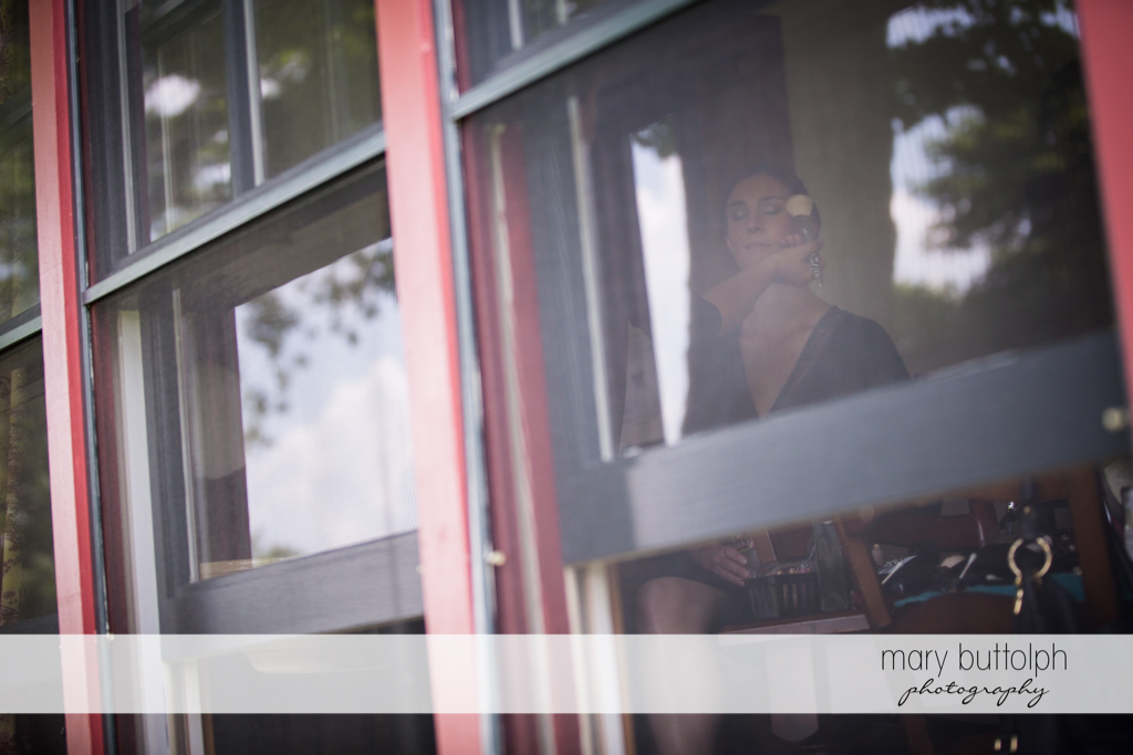 Bride is seen from the window of her room at the Hamilton Inn Wedding
