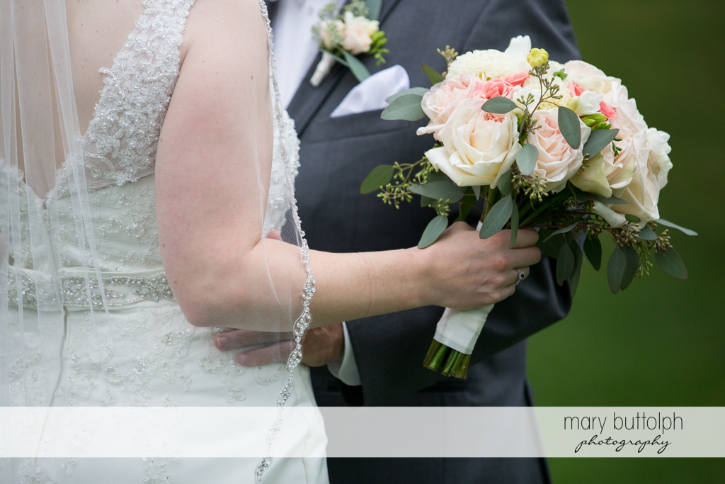 Midsection shot of the couple at the Inns of Aurora Wedding