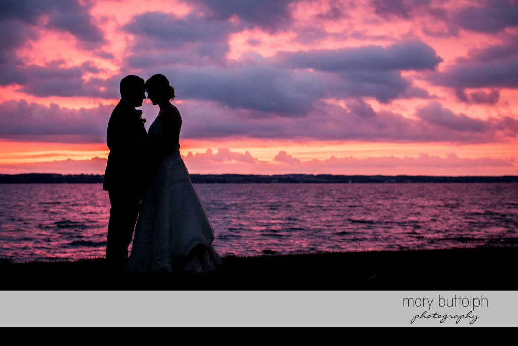 Couple catch the sunset near the lake at the Inns of Aurora Wedding