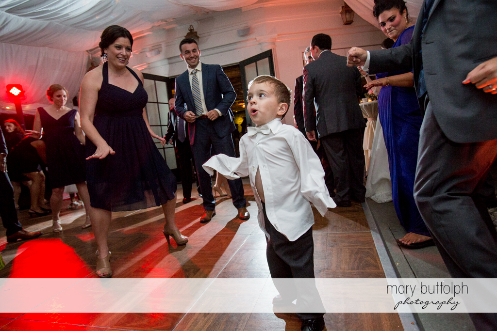 Young boy brings joy to guests on the dance floor at the Inns of Aurora Wedding