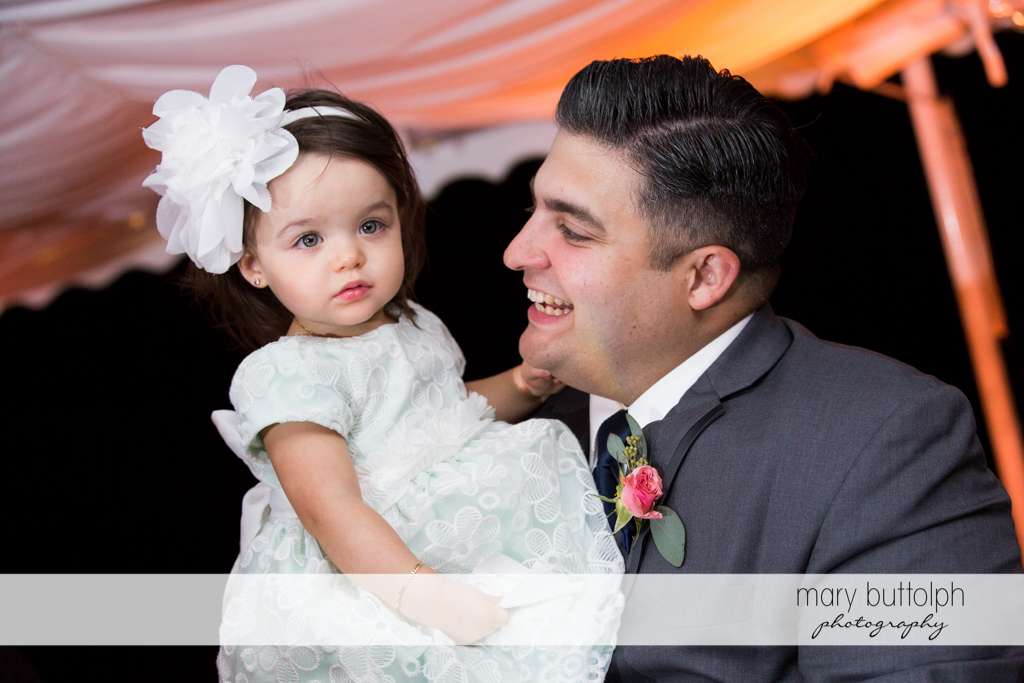 Guest carries a young girl at the Inns of Aurora Wedding