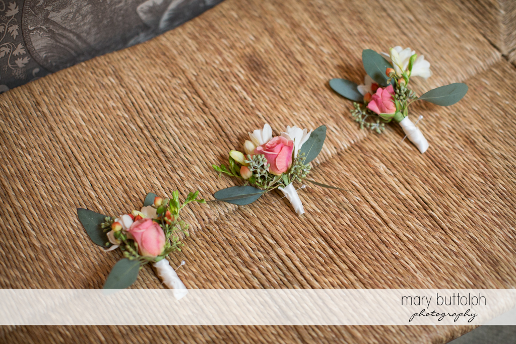 Corsages on display at the Inns of Aurora Wedding