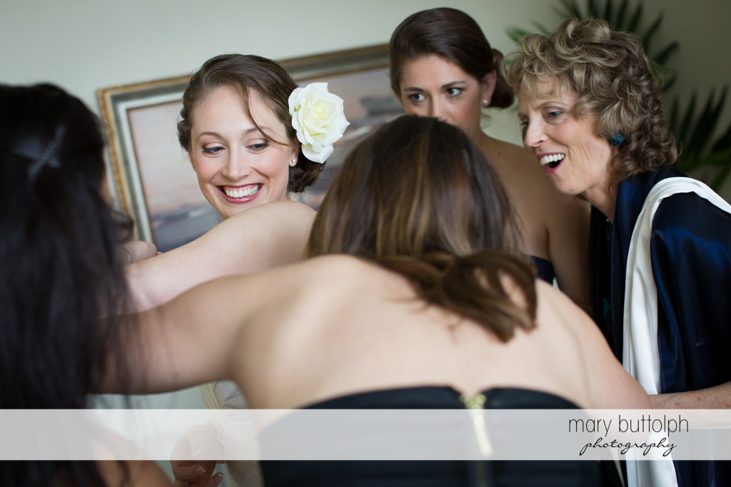 Bride is surrounded by friends at Anyela's Vineyards Wedding