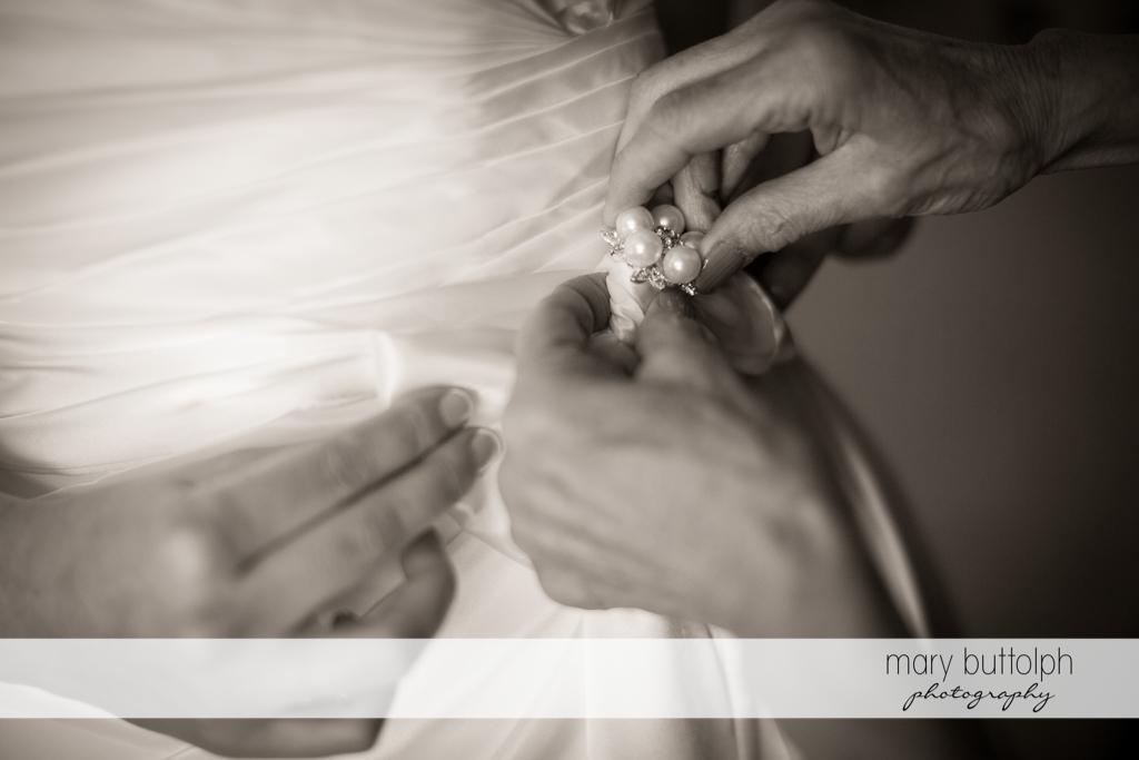 Close up shot of bride's wedding gown at Anyela's Vineyards Wedding
