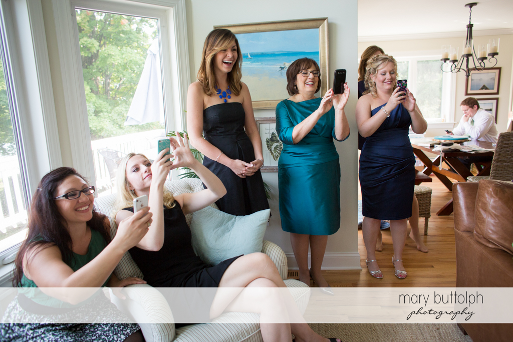 Wedding party takes a photo of the bride with their mobile phones at Anyela's Vineyards Wedding