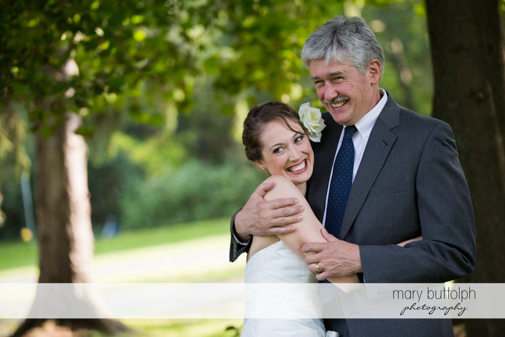 Bride with her father in the garden at Anyela's Vineyards Wedding