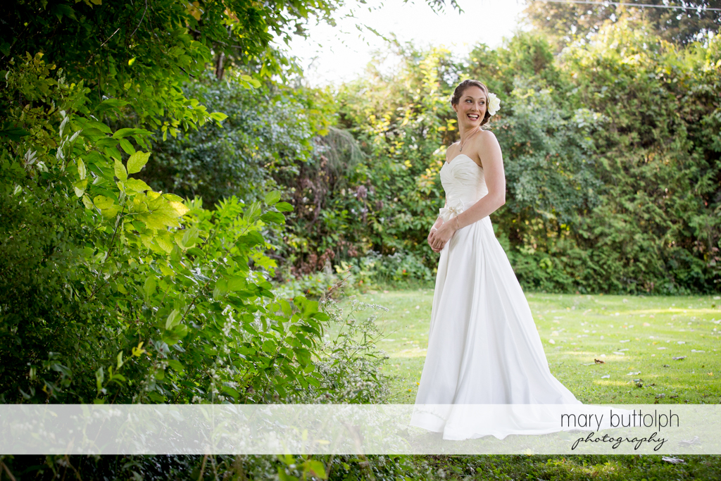 Bride poses for posterity in the garden at Anyela's Vineyards Wedding