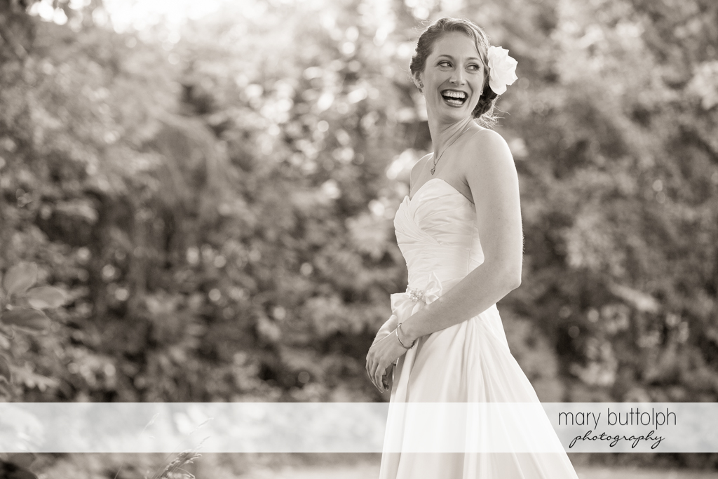 Beautiful black and white shot of the bride in the garden at Anyela's Vineyards Wedding