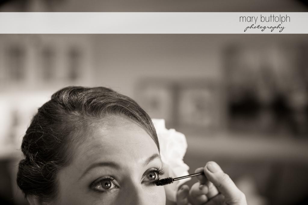 Mascara is applied to the bride's eyelashes at Anyela's Vineyards Wedding