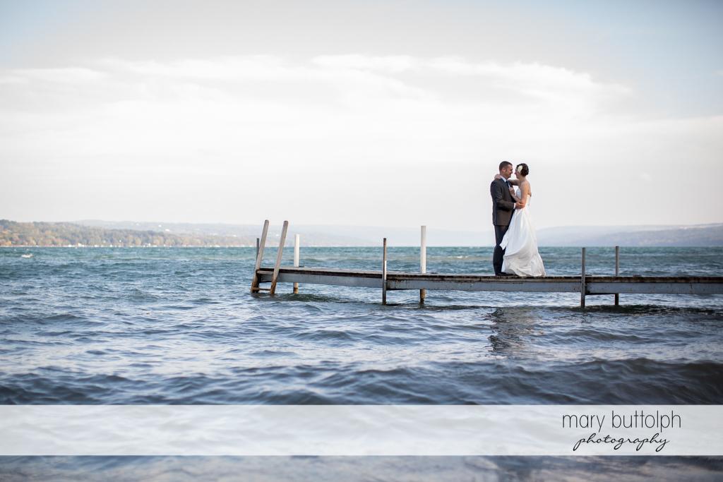 Long shot of the couple on the docks at Anyela's Vineyards Wedding