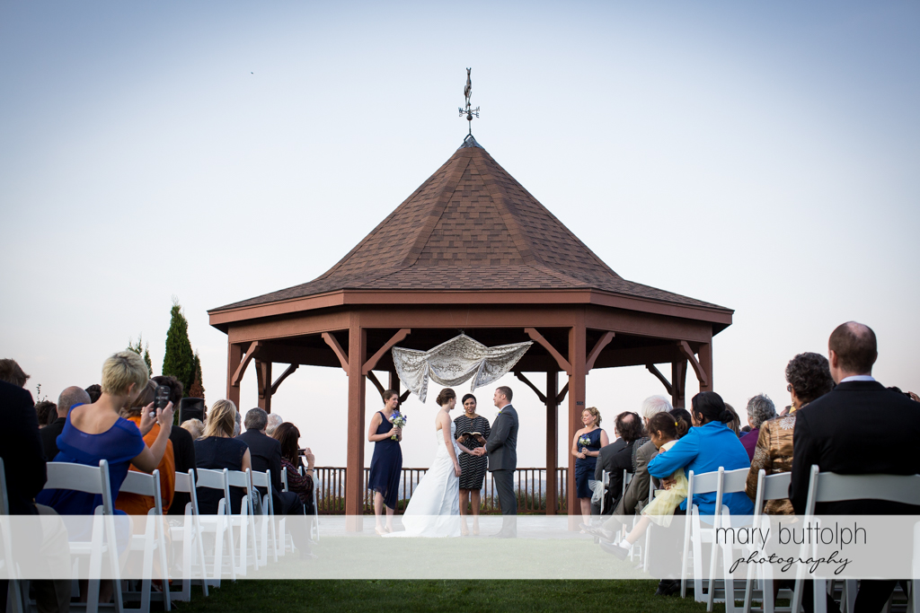 Couple have a garden wedding at Anyela's Vineyards Wedding