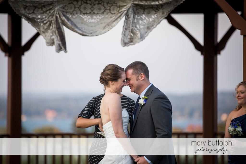 Couple rub noises during the wedding ceremony at Anyela's Vineyards Wedding