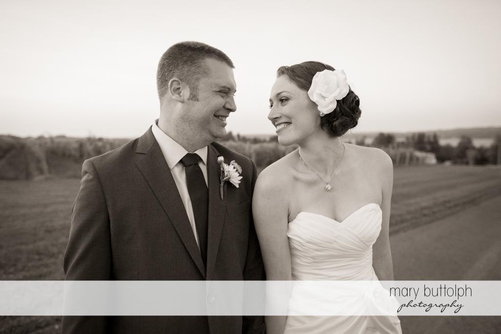 Couple stroll in the vineyard at Anyela's Vineyards Wedding