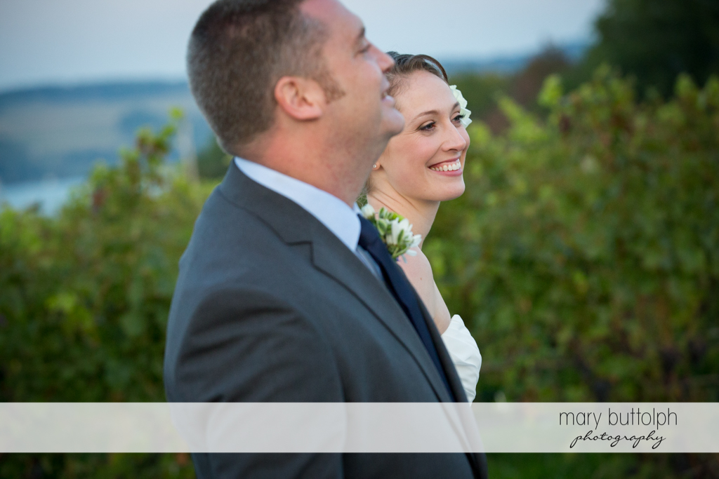 Side view of the happy couple at Anyela's Vineyards Wedding