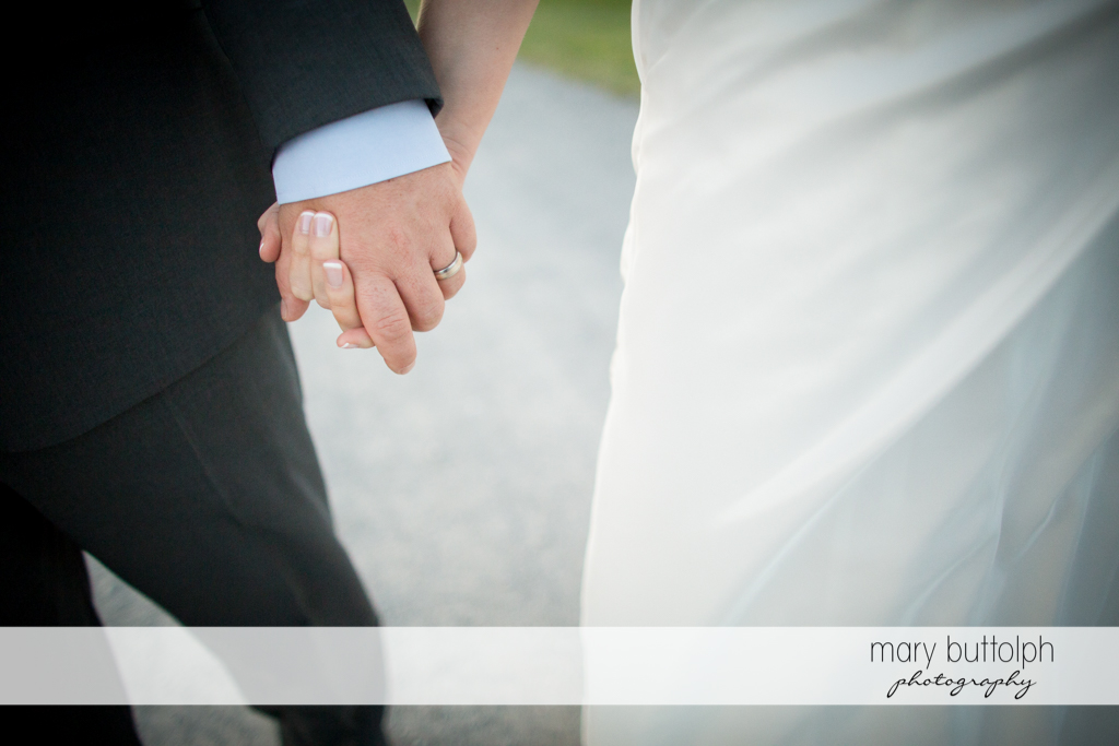 Close up shot of the couple's hands at Anyela's Vineyards Wedding