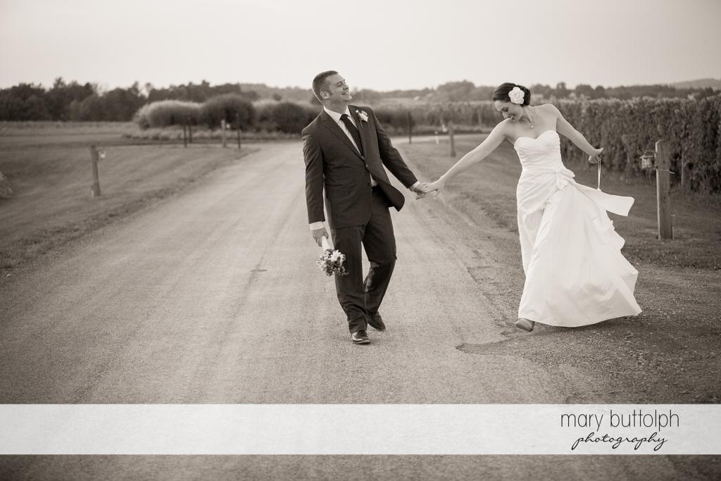 Couple enjoy the vineyards at Anyela's Vineyards Wedding