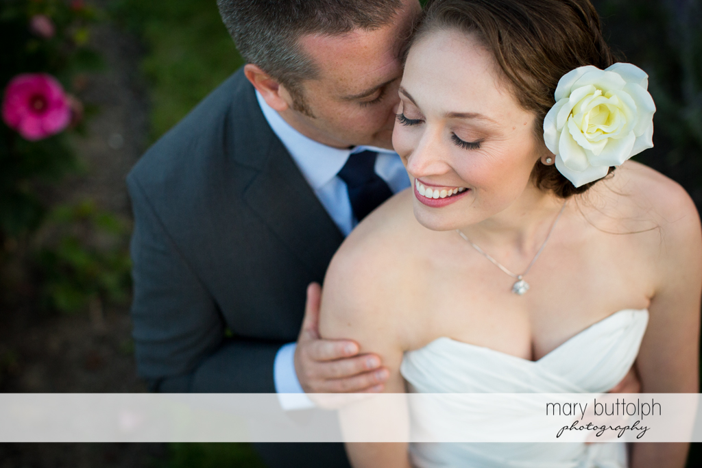 Couple spend time together in the garden at Anyela's Vineyards Wedding