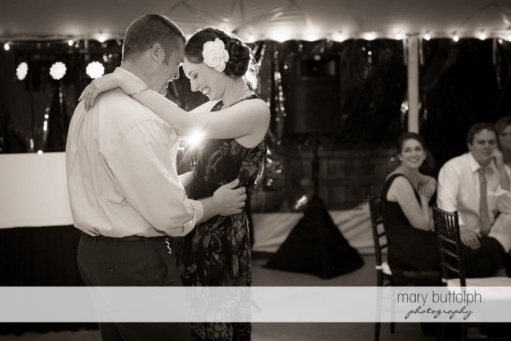 Couple dance under the wedding tent at Anyela's Vineyards Wedding